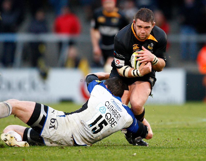Photo: Richard Lane/Richard Lane Photography. London Wasps v Bath Rugby. LV=Cup. 14/11/2010. Wasps' Ben Broster is tackled by Bath's Jack Cuthbert.
