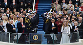 President Donald Trump and ex-President Barack Obama listen to the National Anthem sung by 16-year-old Jackie Evancho at the end of the Inauguration Ceremony on January 20, 2017 in Washington, D.C.  Trump became the 45th President of the United States.    <br /> Credit: Pat Benic / Pool via CNP