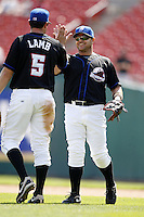 May 23, 2009:  First Baseman Javier Valentin of the Buffalo Bisons, International League Triple-A affiliate of the New York Mets, high fives Mike Lamb after a game at Coca-Cola Field in Buffalo, NY.  Photo by:  Mike Janes/Four Seam Images