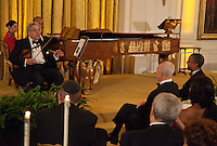 Violinist Itzhak Perlman performs for United States President Barack Obama and President Shimon Peres of Israel during a dinner in honor of Peres receiving the Presidential Medal of Freedom, in the East Room of the White House in Washington, D.C. on Wednesday, June 13, 2012..Credit: Martin Simon / Pool via CNP /MediaPunch
