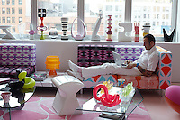 Karim Rashid in his New York apartment which is filled with colourful furniture and a collection of contemporary sculptures
