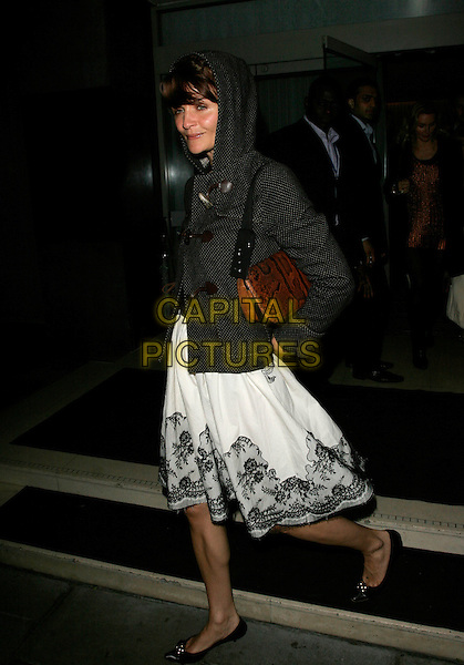 HELENA CHRISTENSEN.Attends Suka, An evening at Sanderson in aid of CLIC Sargent, The Sanderson, Berners Street,.London, England, May 15th 2007..full length white black lace dress polka dot duffle jacket coat hood up brown bag flat pumps shoes.CAP/AH.©Adam Houghton/Capital Pictures.