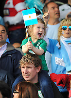 A young girl in the crowd  waves an Argentina flag in support. Rugby World Cup Pool C match between Argentina and Georgia on September 25, 2015 at Kingsholm Stadium in Gloucester, England. Photo by: Patrick Khachfe / Onside Images