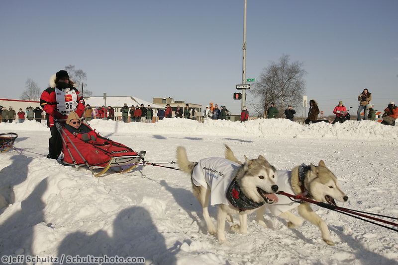 March 3, 2007   Karen Ramstead's team takes the turn at Cordova Street during the Iditarod ceremonial start day in Anchorage
