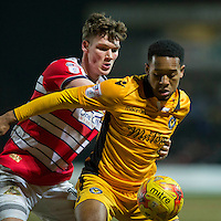 Jaanai Gordon of Newport County shields the ball from Joe Wright of Doncaster Rovers during the Sky Bet League 2 match between Newport County and Doncaster Rovers at Rodney Parade, Newport, Wales on 10 February 2017. Photo by Mark  Hawkins / PRiME Media Images.