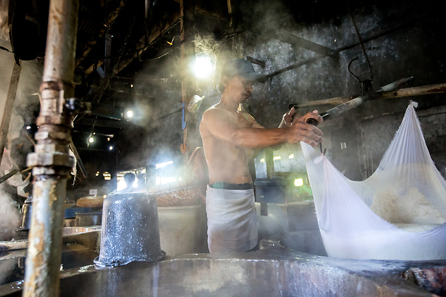 21 May 2019, Klagen Tropodo, East Java, Indonesia: A local man works at a factory producing tofu at Klagen Tropodo village outside Surabaya, Indonesia. Millions of tonnes of recyclable plastic trash from Australia and Europe is dumped for rag pickers to separate and sort. The plastics are used to fuel fires at local tofu factories among other industries. Australia is illegally sending non recyclable trash hidden within this lode and the Indonesian Government is cracking down on the practice and preparing to refuse to take Australia's rubbish that is creating environmental and health issues locally. Picture by Graham Crouch/The Australian