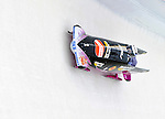 18 December 2010: Sandra Kiriasis pilots her 2-man bobsled for Germany, on her way to taking the gold at the Viessmann FIBT World Cup Bobsled Championships on Mount Van Hoevenberg in Lake Placid, New York, USA. Mandatory Credit: Ed Wolfstein Photo