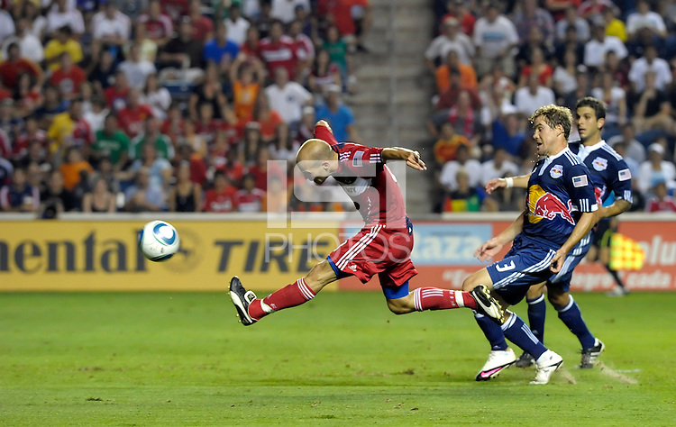 Chicago midfielder Freddie Ljungberg (8) fires a shot in front of New York defenders Chris Albright (3) and Carlos Mendes (44).  The Chicago Fire tied the New York Red Bulls 0-0 at Toyota Park in Bridgeview, IL on August 8, 2010