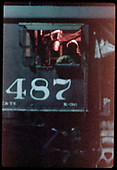 Close view of cab window of C&amp;TS #487 K-36 with man inside cab.<br /> C&amp;TS  Chama, NM