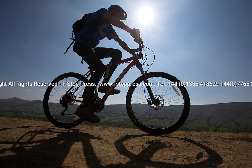 21/04/15<br /> <br /> On the week of the fiftieth anniversary of The Pennine Way, the sun beats down on a cyclist near the start of Britain's first national trail near Edale, in the Derbyshire Peak District. <br /> <br /> All Rights Reserved - F Stop Press.  www.fstoppress.com. Tel: +44 (0)1335 418629 +44(0)7765 242650