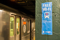 A poster in the subway in New York on Friday,January 8, 2016 announces the availability of free wi-fi service. (© Richard B. Levine)