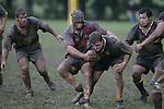 B. Tribe is tackled by J. Thomas. Counties Manukau Premier 2 Championship game between Bombay and Papakura played at Bombay on May 13th, 2006. Papakura won 8 - 7.