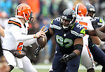 Seattle Seahawks defensive tackle Brandon Mebane (92) pressures and sacks Cleveland Browns quarterback Johnny Manizel (2) at CenturyLink Field in Seattle, Washington on December 20, 2015. The Seahawks clinched their fourth straight playoff berth in four seasons by beating the Browns 30-13.  ©2015. Jim Bryant Photo. All Rights Reserved.