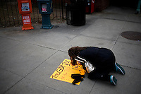 Occupy protesters create signs at the Occupy New Hampshire and Occupy the Primary gathering in Veterans Memorial Park in Manchester, New Hampshire on Jan. 7, 2012.  The New Hampshire GOP presidential primary is on Jan. 10.