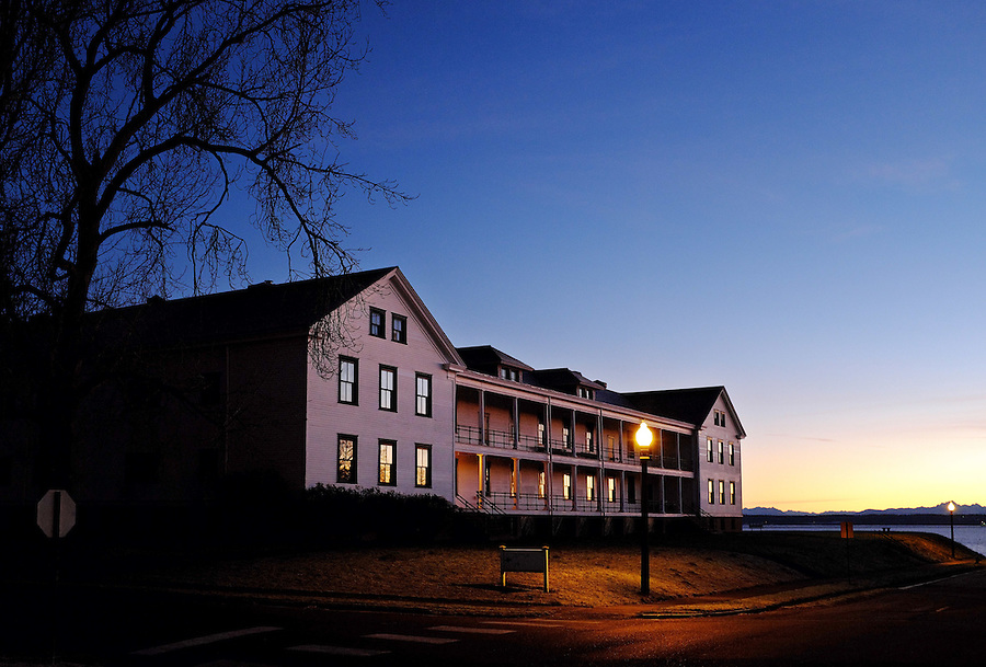 Dawn rises over old headquarters barracks, Fort Worden State Park, Port Townsend, Washington, USA