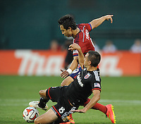 Washington D.C. - July 21, 2014:  Davy Arnaud (8) of D.C. United goes against Erick Torres of Chivas USA. D.C. United defeated the Chivas USA 3-1 during a Major League Soccer match for the 2014 season at RFK Stadium.