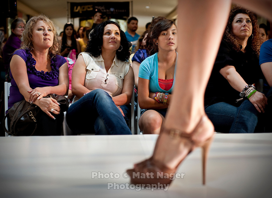 Women watch as a model walks down the catwalk during during the Macy's Runway Fashion Show at La Plaza Mall in McAllen, Texas, Saturday, April 3, 2010. Stores within the La Plaza Mall have done well throughout the economic crisis due to its proximity to Mexico and the influx of Mexican tourists who purchase goods to bring back home. ..PHOTO/ Matt Nager