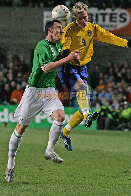Dublin Ireland, Sweeden no 9 Christian Wilhelmsson vies for the ball against the defence of the Irish no 5 Andy O'Brien during the friendly international match in Lansdowne Road Dublin 1/3/06..Photo EPA Aiden Crawley..(Photo credit should read EPA Photo/Aiden Crawley...This Picture has been sent you under the condtions enclosed by:.Newsfile Ltd..the Studio,.Millmount Abbey,.Drogheda,.Co Meath..Ireland..Tel: +353(0)41-9871240.Fax: +353(0)41-9871260.GSM: +353(0)86-2500958.email: pictures@newsfile.ie.www.newsfile.ie.FTP: 193.120.102.198..This picture is from Fran Caffrey@newsfile.ie