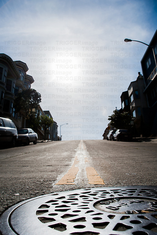 Low street view of San Francisco street with manhole