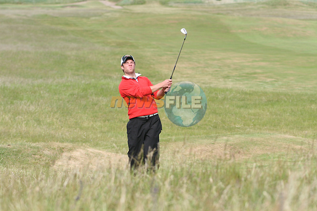 Shane Smyth of Co.Louth Golf Club hitting onto the 3rd green on day 2 of the 2010 East of Ireland Amateur Golf Competition in Co.Louth Golf Club..Photo NEWSFILE/Jenny Matthews.(Photo credit should read Jenny Matthews/NEWSFILE)....This Picture has been sent you under the condtions enclosed by:.Newsfile Ltd..The Studio,.Millmount Abbey,.Drogheda,.Co Meath..Ireland..Tel: +353(0)41-9871240.Fax: +353(0)41-9871260.GSM: +353(0)86-2500958.email: pictures@newsfile.ie.www.newsfile.ie.FTP: 193.120.102.198.