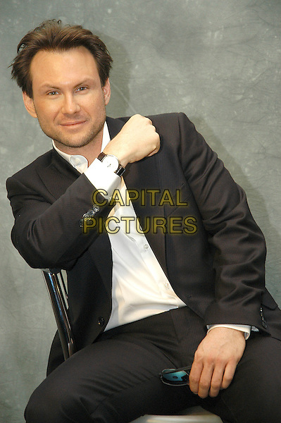 """CHRISTIAN SLATER.Photocall for """"Bobby"""" at Cinema the four Fontana's, Rome, Italy.  .January 19th, 2007.half length black suit jacket sitting watch.CAP/CAV.©Luca Cavallari/Capital Pictures"""