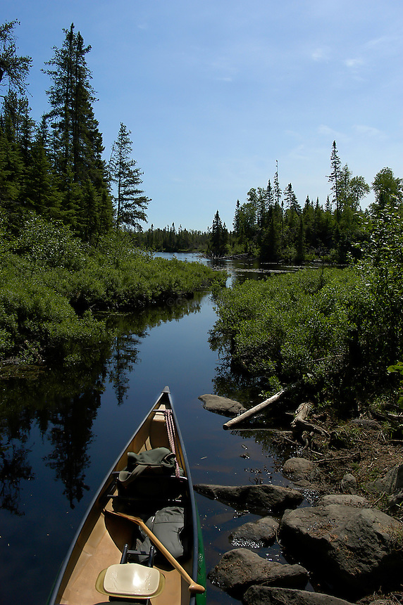 Solo canoe on stream near Homer Lake Boundary Waters canoe area wilderness, Minnesota.