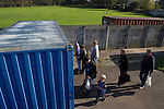 Lancaster City 0 FC Halifax Town 3, 15/10/2011, Giant Axe, FA Cup Third Qualifying Round. A small group of spectators arriving at the turnstiles at Lancaster City's Giant Axe ground prior to the club's FA Cup third qualifying round match against FC Halifax Town. The visitors, who play two leagues above their hosts in the English football pyramid, won the ties by three goals to nil, watched by a crowd of 646 spectators. Lancaster City were celebrating their centenary in 2011, although there was a dispute over the exact founding date over the club known as Dolly Blue. Photo by Colin McPherson.