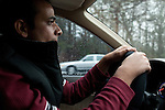 December 16, 2010. Raleigh, NC.. TP Mishra drives to pick up his wife from the shopping mall where she works. He will then drop her off at her second job in food service. Mr. Mishra has been driving for just over a month and that has been a big change from life in NYC to life in North Carolina.. TP Mishra, a refugee from Bhutan, has recently relocated from the Bronx to Raleigh, where he lives in an suburban apartment  with his wife, as well as another Bhutanese couple.