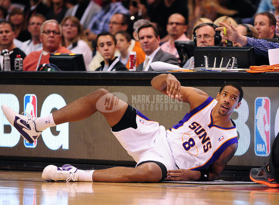 Mar. 2, 2012; Phoenix, AZ, USA; Phoenix Suns forward/center Channing Frye falls to the ground during the game against the Los Angeles Clippers at the US Airways Center. The Suns defeated the Clippers 81-78. Mandatory Credit: Mark J. Rebilas-USA TODAY Sports