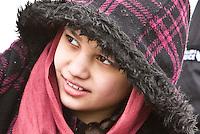 St Patricks Day parade High Street Digbeth.Crop Asian girl watching parade Camp Hill Bordesley