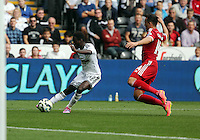 Pictured L-R: Nathan Dyer of Swansea crosses the ball, closely marked by Jason Davidson of West Bromwich Albion. Saturday 30 August 2014<br /> Re: Premier League, Swansea City FC v West Bromwich Albion at the Liberty Stadium, south Wales, UK