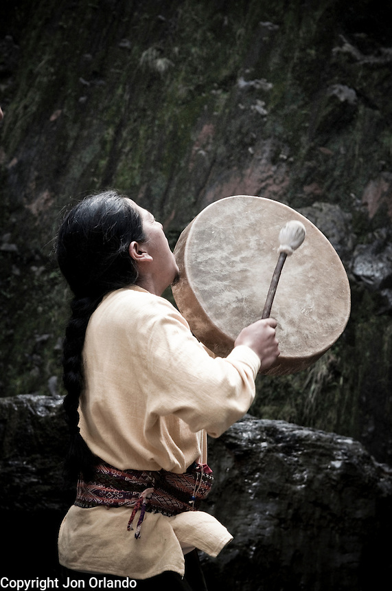 Guillermo Santillán, a member of The Pakarinka Sisari Ancestral Wisdom Center near Otavalo, Ecuador, drums during a ceremony honoring water.