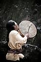 Guillermo Santillán, a member of The Pakarinka Sisari Ancestral Wisdom Center near Otavalo, Ecuador, drums during a ceremony honoring water.