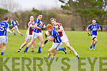 Laune Rangers Tom McGillicuddy is tackled by Cromanes Donnacha Walsh during their abandoned Mid Kerry semi final in Cromane on St Stephens Day.