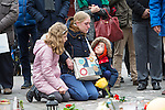 "BRUSSELS - BELGIUM - 23 March 2016 -- Belgium in mourning after the terrorist attack in  Maelbeek metro station - EU quarters, and the Brussels airport in Zaventem. -- Mother with her children feeling the loss and sorrow at the ""memorial"" at the Bourse in the city center. -- PHOTO: Juha ROININEN / EUP-IMAGES"