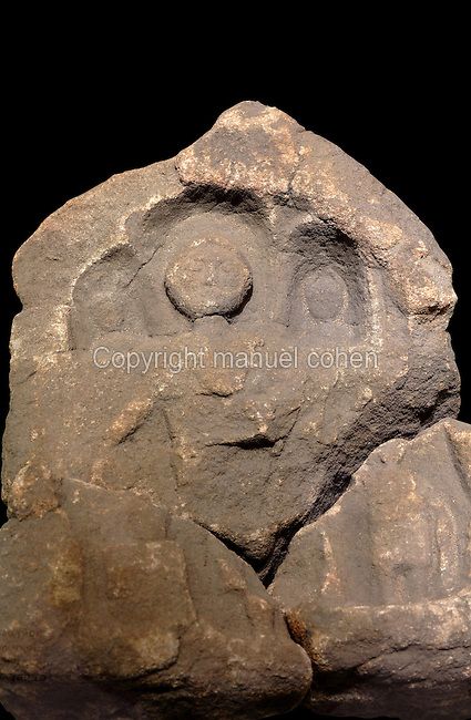 Roman stone relief carving of Maponos, the Celtic god of eternal youth, with a short beard and small pointed cap, with the Roman god Apollo and goddess Diana in niches either side of his head, in the Vindolanda Museum, Hadrian's Wall, Northumberland, England. Maponos was worshipped in the North of Britan, with a possible cult centre near Gretna Green. Hadrian's Wall was built 73 miles across Britannia, now England, 122-128 AD, under the reign of Emperor Hadrian, ruled 117-138, to mark the Northern extent of the Roman Empire and guard against barbarian attacks from the Picts to the North. The Vindolanda Museum is run by the Vindolanda Charitable Trust and forms part of the Hadrian's Wall UNESCO World Heritage Site. Picture by Manuel Cohen