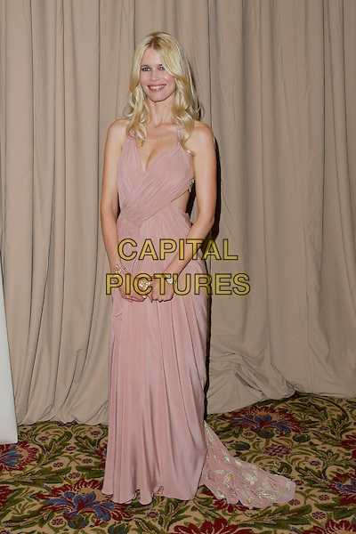 CLAUDIA SCHIFFER.Saks Fifth Avenue's Unforgettable Evening.Benefiting Women's Cancer Research Fund.held at the Regent Beverly Wilshire Hotel, Beverly Hills, USA, 1st March 2005..full length long pink backless dress gold clutch bag cut out sides.Ref: ADM.www.capitalpictures.com.sales@capitalpictures.com.©JWong/AdMedia/Capital Pictures .