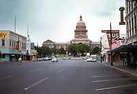 Vintage view of downtown Austin and the Texas Capitol in August 1956, in simpler times before technology. Downtown Congress Avenue was the retail hub of Austin, Texas.