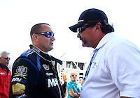 Jul. 21, 2013; Morrison, CO, USA: NHRA top fuel dragster driver Brandon Bernstein (left) talks with Gary Scelzi during the Mile High Nationals at Bandimere Speedway. Mandatory Credit: Mark J. Rebilas-