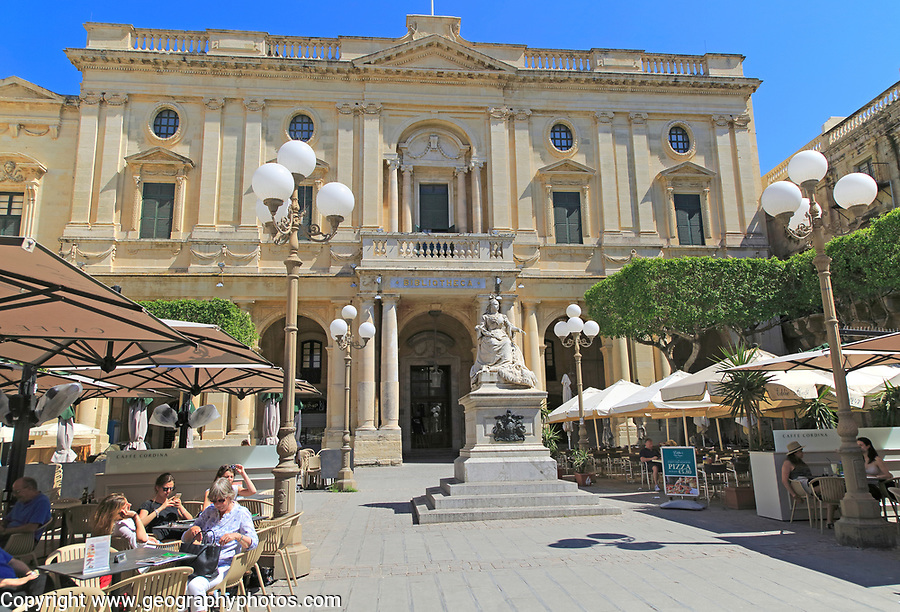 National Library building Queen Victoria statue and cafes in Republic Square, Valletta, Malta