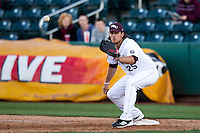 Brock Chaffin (25) of the Missouri State Bears eyes a ball thrown to first base during a game against the Southern Illinois University- Edwardsville Cougars at Hammons Field on March 9, 2012 in Springfield, Missouri. (David Welker / Four Seam Images)