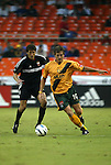 17 July 2004: Brandon Prideaux (left) and Andreas Herzog  (10). Los Angeles Galaxy tied DC United 1-1 at RFK Stadium in Washington, DC during a regular season Major League Soccer game..
