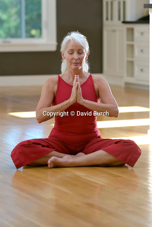 Mature woman sitting in lotus position