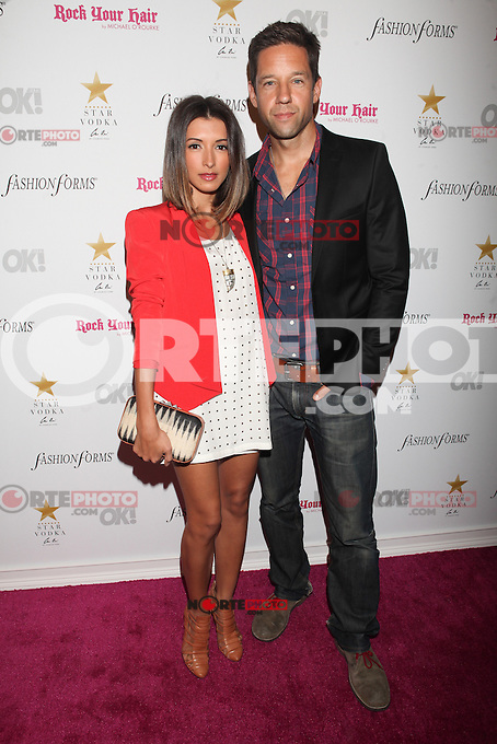NEW YORK, NY - SEPTEMBER 10: India De Beaufort and Todd Grinnell attend OK! MAGAZINE'S 4TH ANNUAL FASHION WEEK CELEBRATION AT Cielo in New York City, NY. September 10, 2012. &copy; Diego Corredor/MediaPunch Inc. /NortePhoto.com<br />