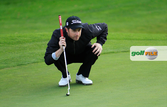 Daniel Sugrue (Killarney Golf &amp; Fishing Club) on the 7th green during Round 2 of The Cassidy Golf 103rd Irish PGA Championship in Roganstown Golf Club on Friday 11th October 2013.<br /> Picture:  Thos Caffrey / www.golffile.ie