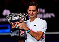Roger Federer of Switzerland celebrates on Day 14 of the Australian Open