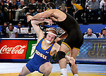 BROOKINGS, SD - DECEMBER 2:   Henry Pohlmeyer from SDSU shoots against Topher Carton from Iowa in their 141 pound match Friday night at Frost Arena in Brookings, SD.(Photo by Dave Eggen/Inertia)