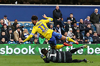 Leeds United's Tyler Roberts competing with Queens Park Rangers' goalkeeper Matt Ingram in the penalty area<br /> <br /> Photographer Andrew Kearns/CameraSport<br /> <br /> The Emirates FA Cup Third Round - Queens Park Rangers v Leeds United - Sunday 6th January 2019 - Loftus Road - London<br />  <br /> World Copyright &copy; 2019 CameraSport. All rights reserved. 43 Linden Ave. Countesthorpe. Leicester. England. LE8 5PG - Tel: +44 (0) 116 277 4147 - admin@camerasport.com - www.camerasport.com