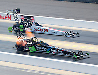 Sep 17, 2016; Concord, NC, USA; NHRA top fuel driver Clay Millican (near) races alongside Richie Crampton during qualifying for the Carolina Nationals at zMax Dragway. Mandatory Credit: Mark J. Rebilas-USA TODAY Sports