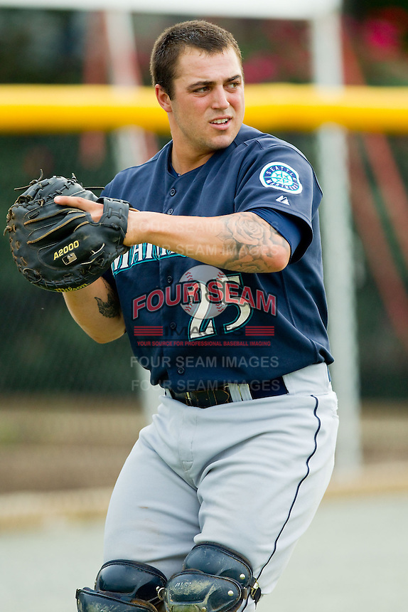 Pulaski Mariners catcher Luke Guarnaccia (25) warms up in the outfield prior to the game against the Burlington Royals at Burlington Athletic Park on July 20, 2013 in Burlington, North Carolina.  The Royals defeated the Mariners 6-5.  (Brian Westerholt/Four Seam Images)